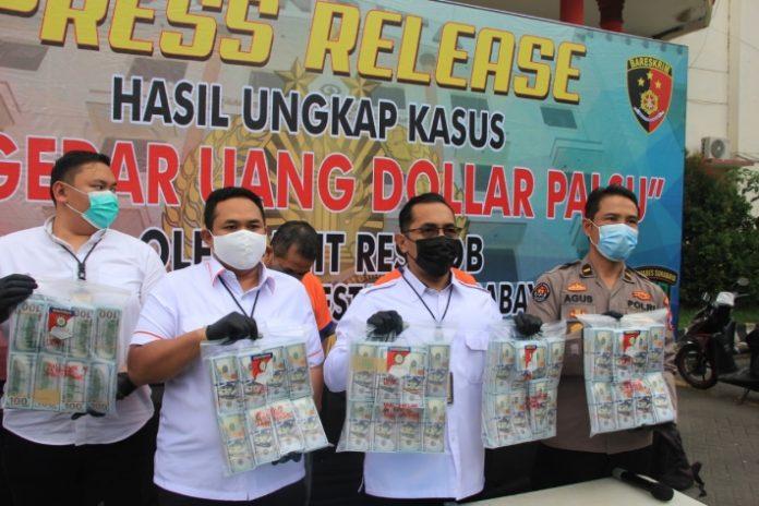 Sat Reskrim Polrestabes Surabaya Ungkap Pengedar dan Penggandaan Uang Dolar Palsu